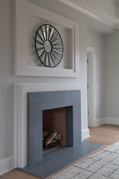 What material (white frame) is around the fireplace stone?
