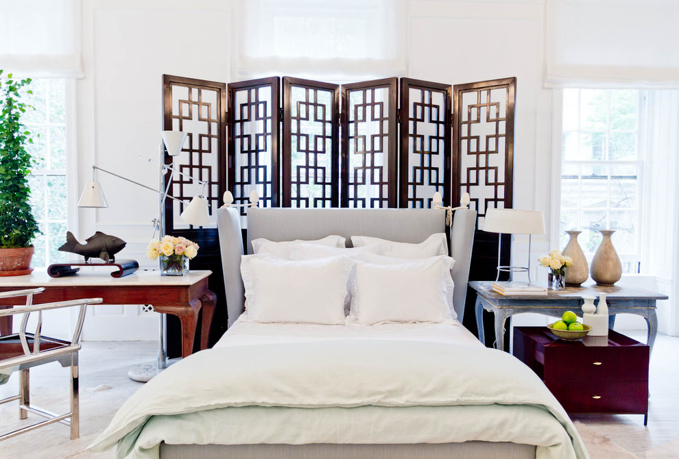 Example of an eclectic carpeted bedroom design in New York with white walls