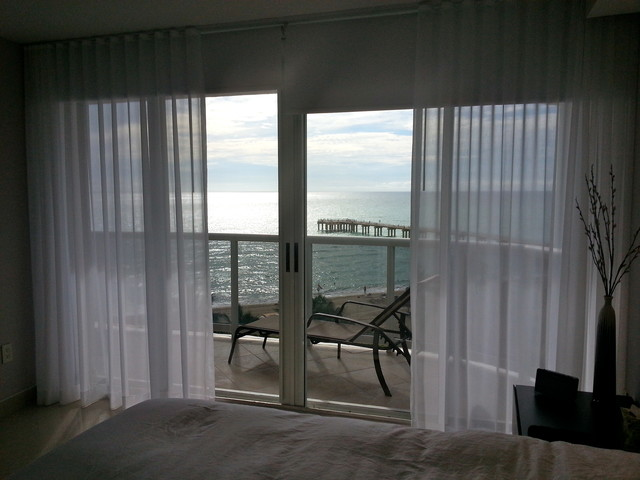 Victoria - White Sheer Panels and Roller Shades beach-style-bedroom