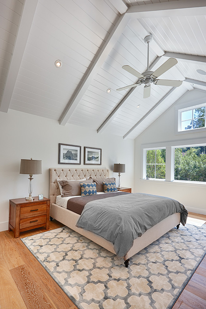 Inspiration for a farmhouse master light wood floor bedroom remodel in San Francisco with white walls