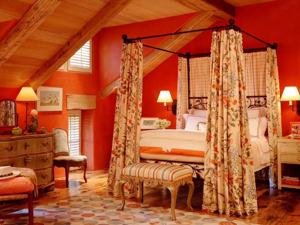 Example of a huge trendy medium tone wood floor and orange floor bedroom design in San Francisco with orange walls and no fireplace