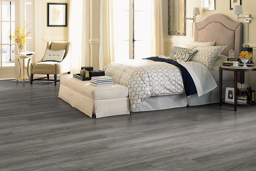 Transitional guest vinyl floor and gray floor bedroom photo in Indianapolis with beige walls and no fireplace