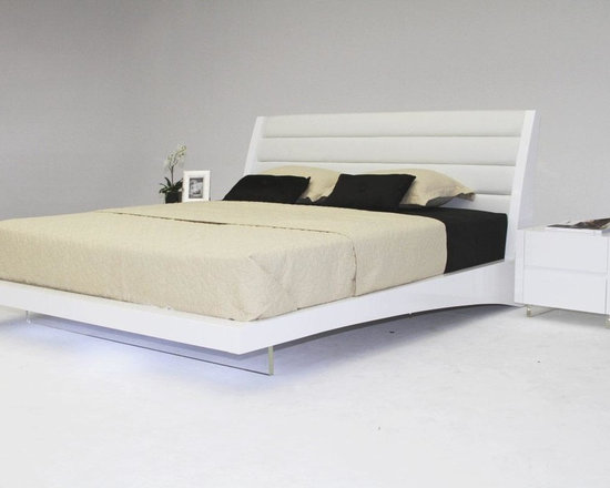 Volterra - Contemporary Floating Bed With Lights - This beautiful bed comes with LED lighting embedded inside of the leather head board bottom. The transparent acrylic leg keeps the illusion of the bed floating. With its elegant design it sure to be the center of attention.