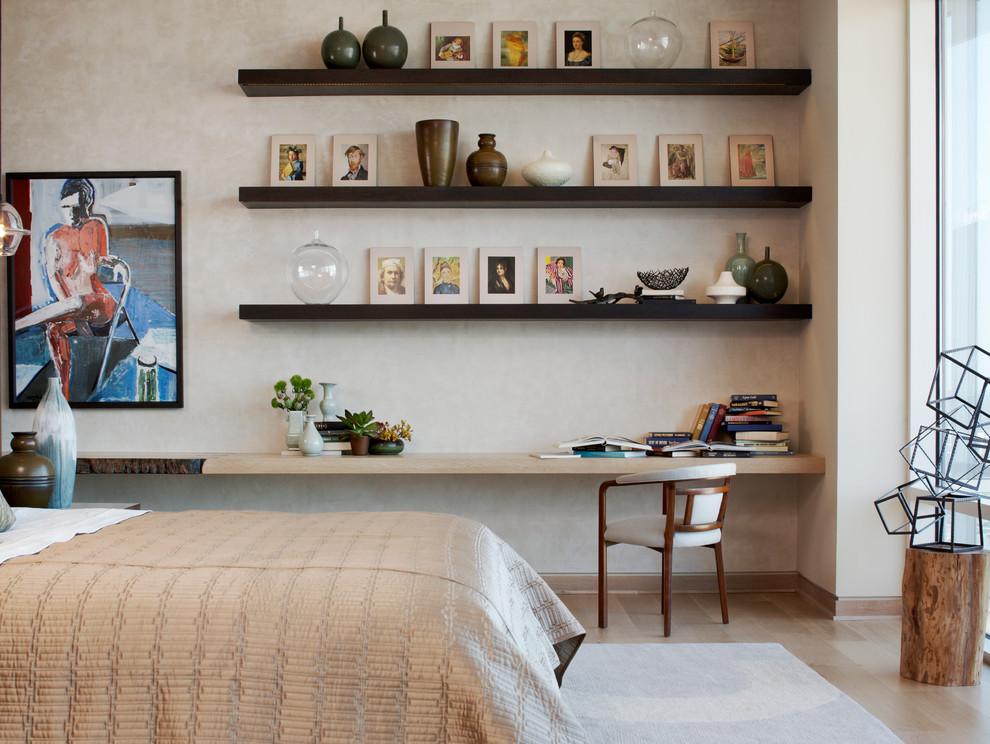 Bedroom - modern medium tone wood floor bedroom idea in New York with beige walls