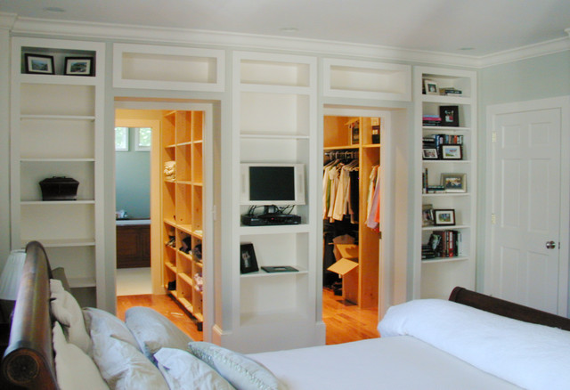 Walk through closets traditional bedroom