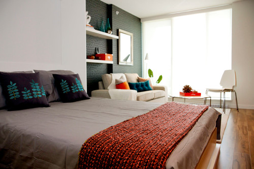 Wall bed in small living space.