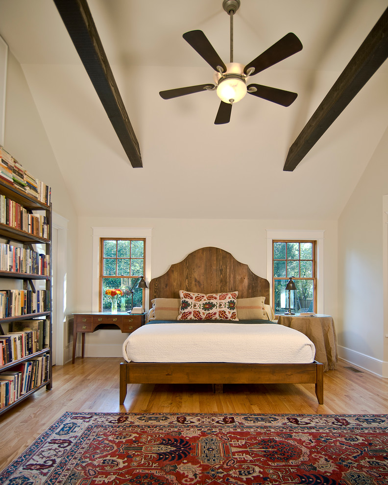 Bedroom - mid-sized contemporary master light wood floor and brown floor bedroom idea in Charlotte with white walls