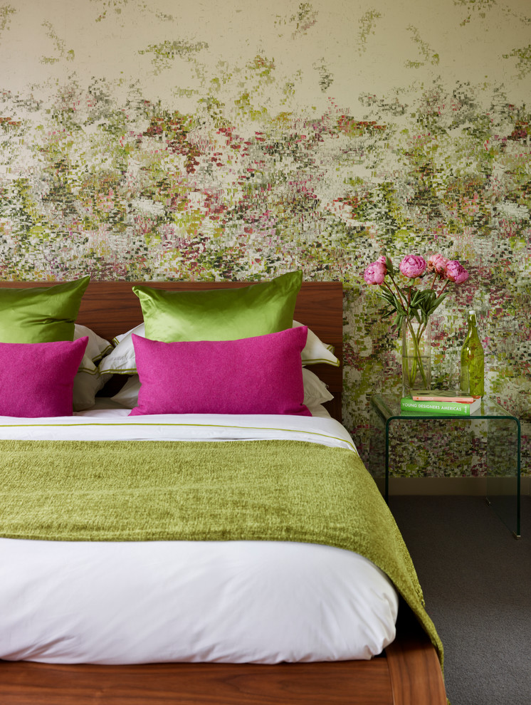 Trendy guest carpeted bedroom photo in London with no fireplace