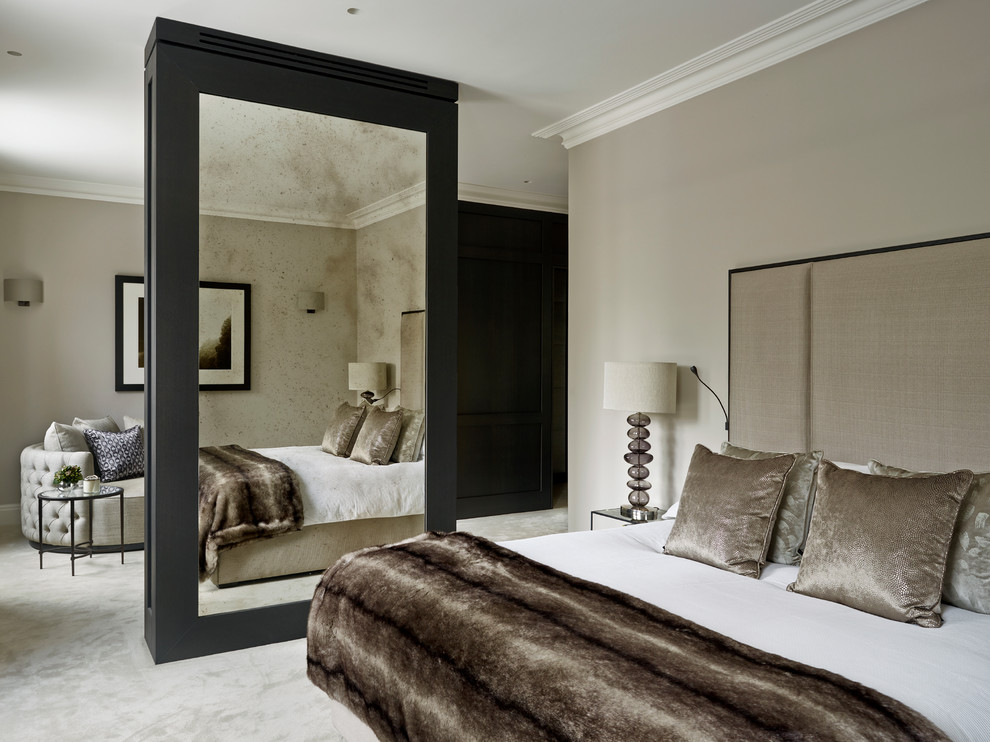 Example of a mid-sized trendy master carpeted bedroom design in London with gray walls and no fireplace