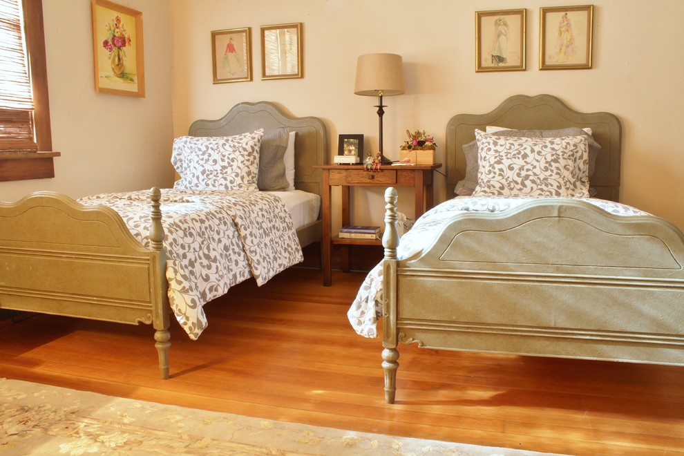 Mid-sized farmhouse guest medium tone wood floor bedroom photo in Seattle with brown walls