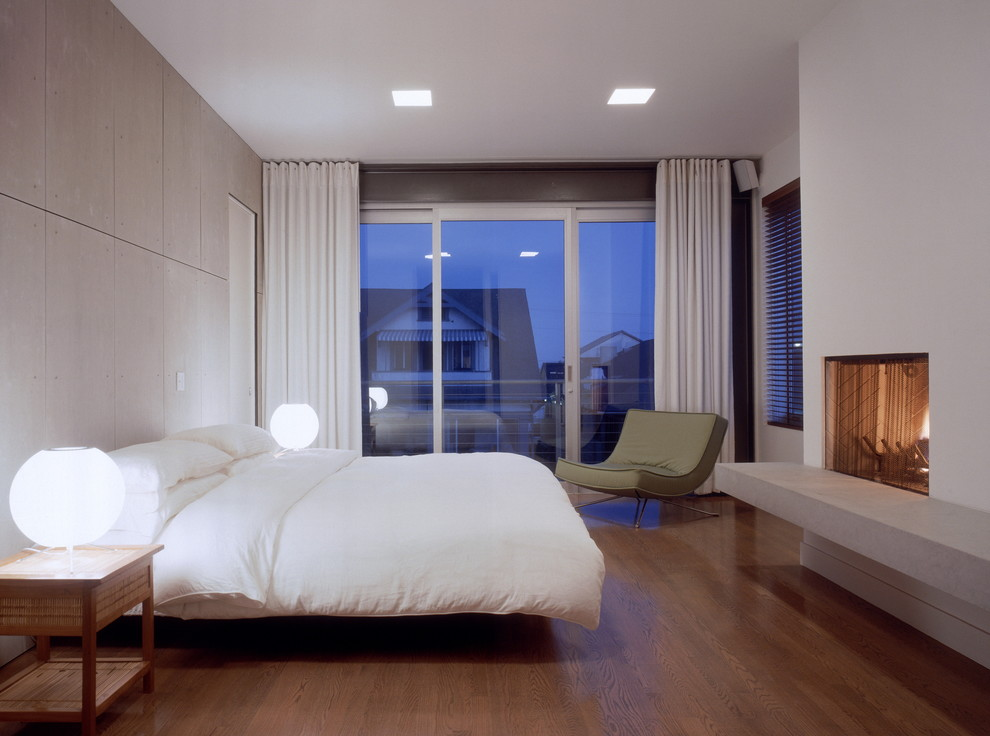 Example of a minimalist bedroom design in Los Angeles with white walls