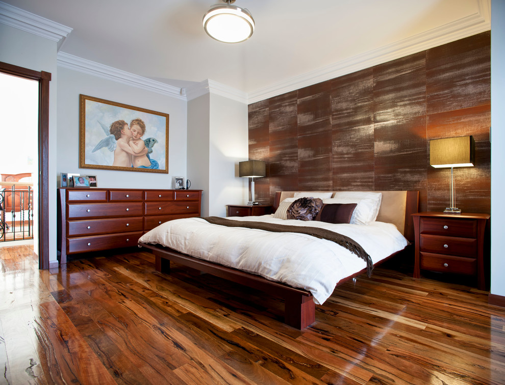 Mid-sized trendy medium tone wood floor and brown floor bedroom photo in Perth with brown walls