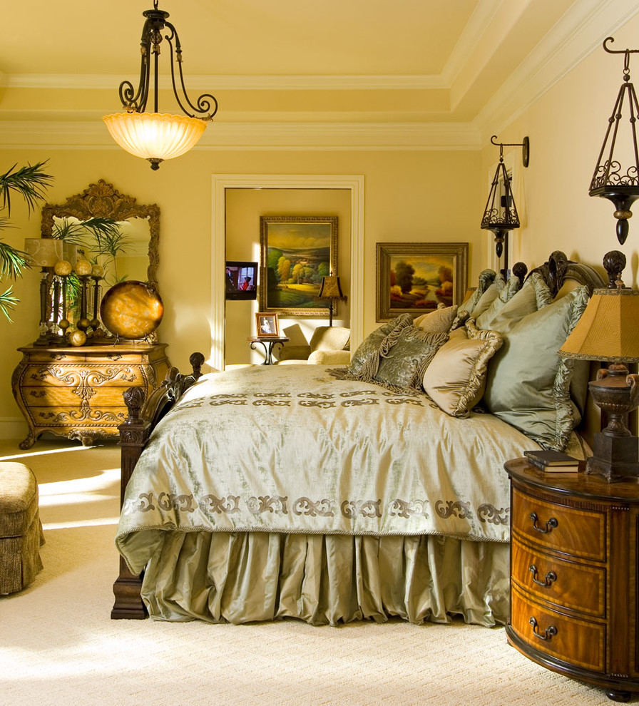 Inspiration for a large timeless master carpeted bedroom remodel in Other with yellow walls