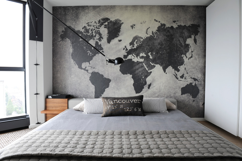 Example of a small trendy master light wood floor bedroom design in Vancouver with gray walls and no fireplace