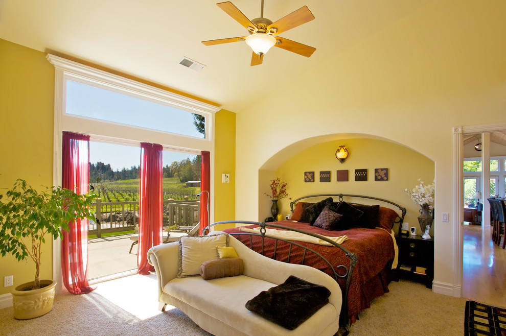 Example of a large transitional master carpeted bedroom design in San Francisco with yellow walls and no fireplace
