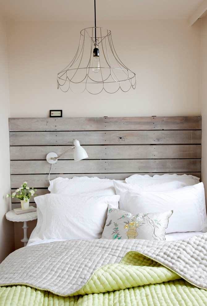 Inspiration for a shabby-chic style bedroom remodel in Vancouver with beige walls