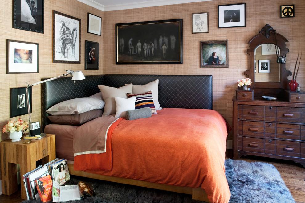 Bedroom - eclectic medium tone wood floor bedroom idea in Los Angeles with beige walls