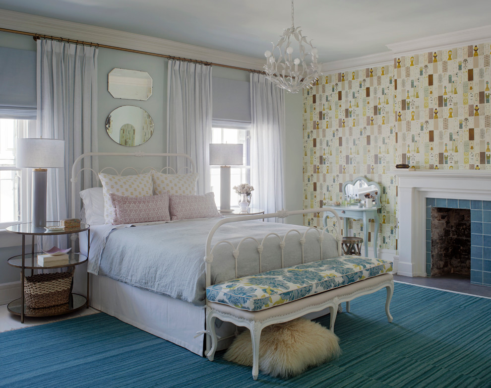 Example of a mid-sized trendy guest carpeted bedroom design in Atlanta with multicolored walls, a standard fireplace and a tile fireplace