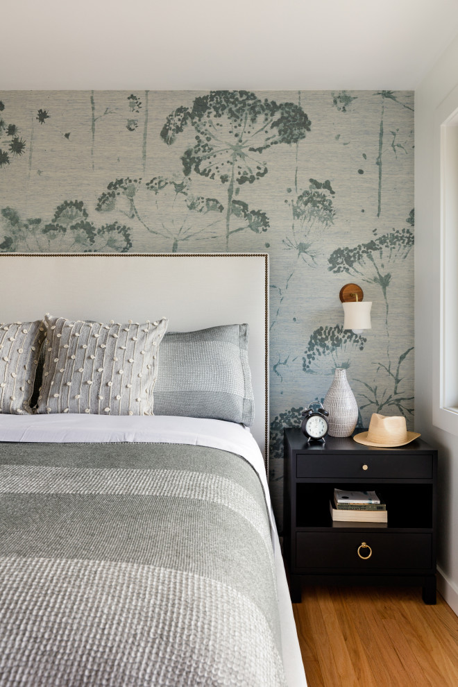 Example of a trendy master bedroom design in Seattle with blue walls