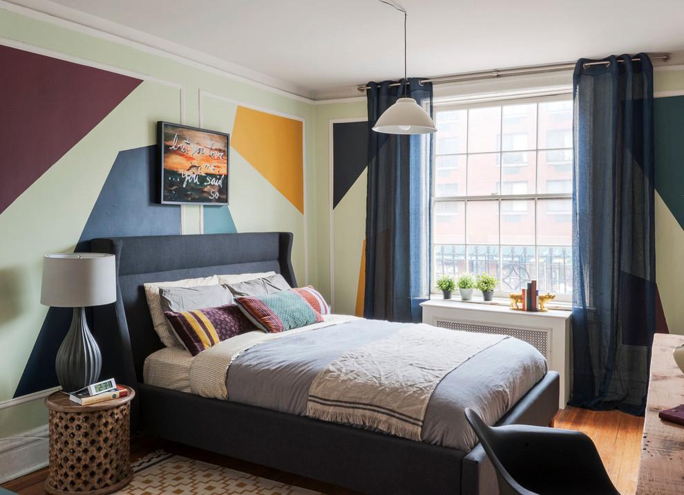 Bedroom - mid-sized eclectic master medium tone wood floor bedroom idea in New York with multicolored walls