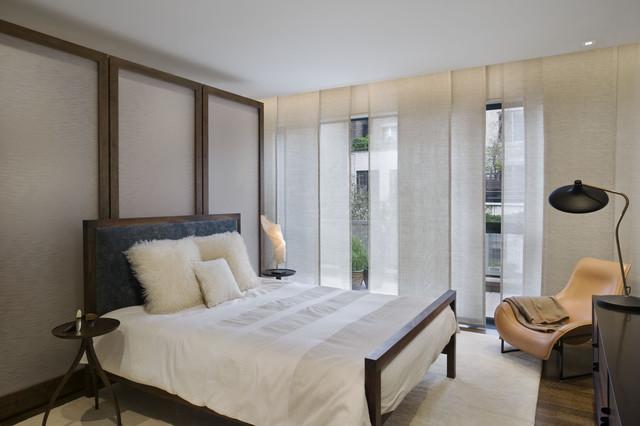 example of a trendy dark wood floor bedroom design in new york