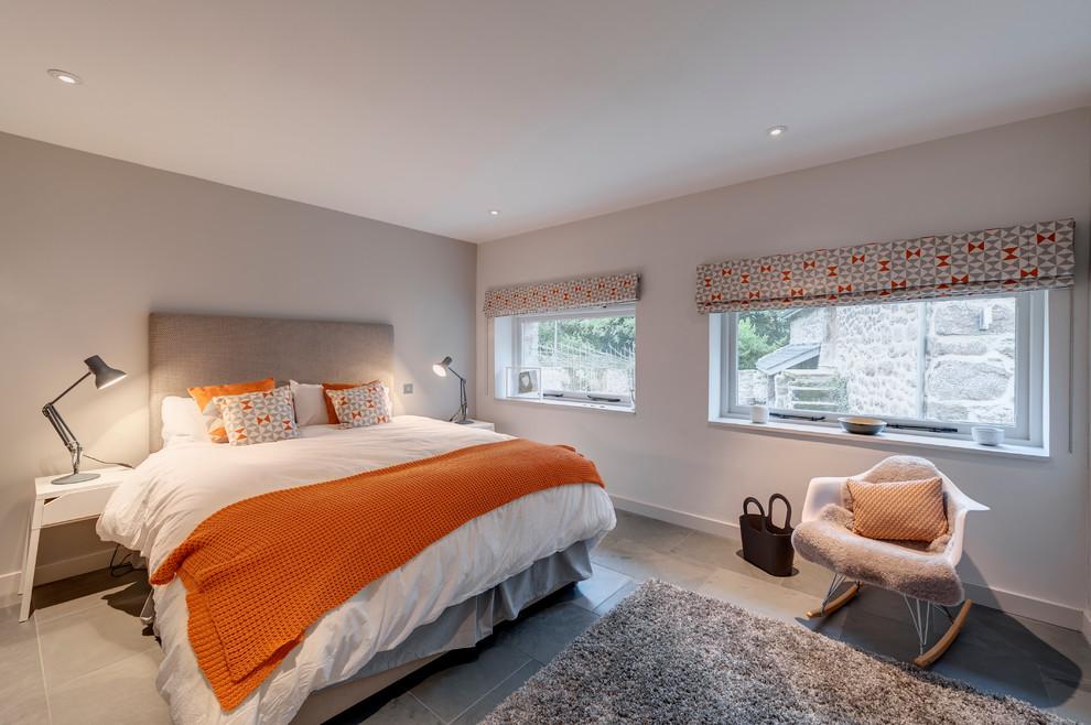 Bedroom - mid-sized contemporary master ceramic tile and gray floor bedroom idea in Devon with gray walls