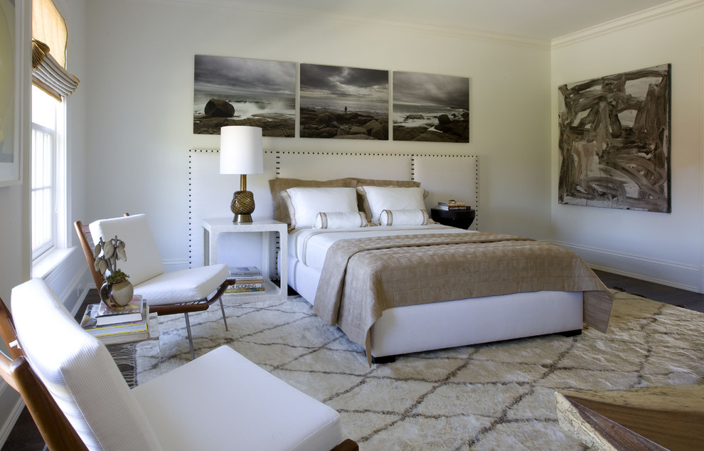 Trendy dark wood floor bedroom photo in New York with white walls and no fireplace
