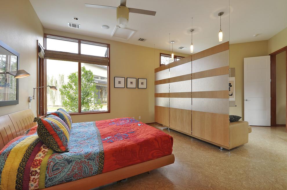 Bedroom - contemporary cork floor bedroom idea in Austin with yellow walls