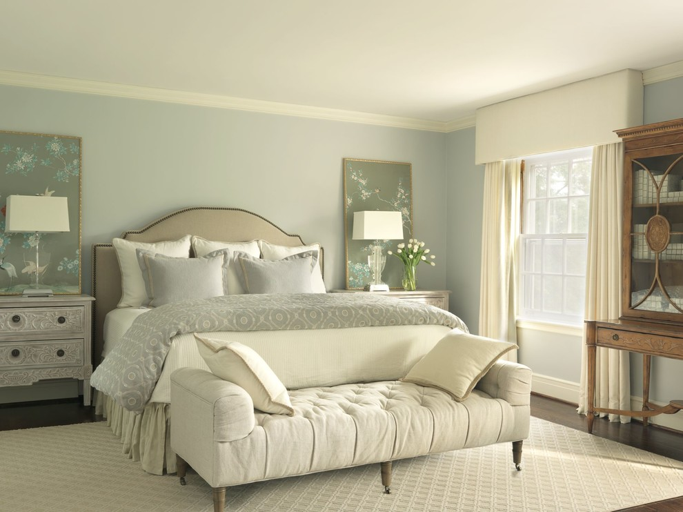 Inspiration for a timeless bedroom remodel in St Louis with blue walls