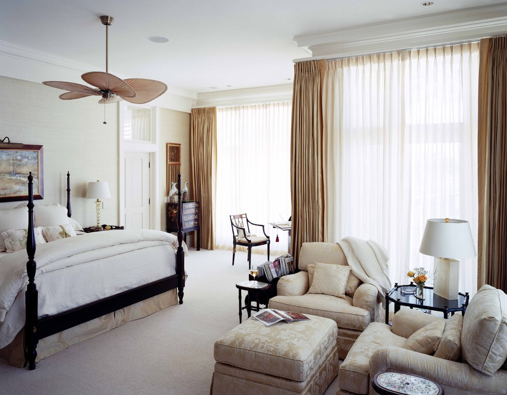 Inspiration for a large timeless master carpeted bedroom remodel in Atlanta with beige walls