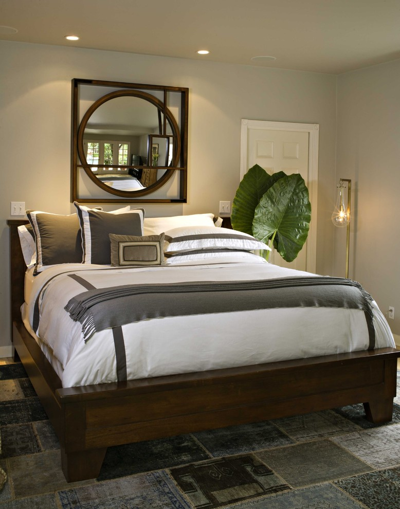 Example of a tuscan bedroom design in Los Angeles with gray walls