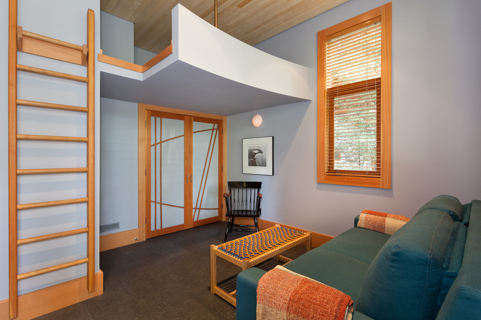 Example of a mid-sized minimalist guest carpeted and gray floor bedroom design in Vancouver with gray walls and no fireplace