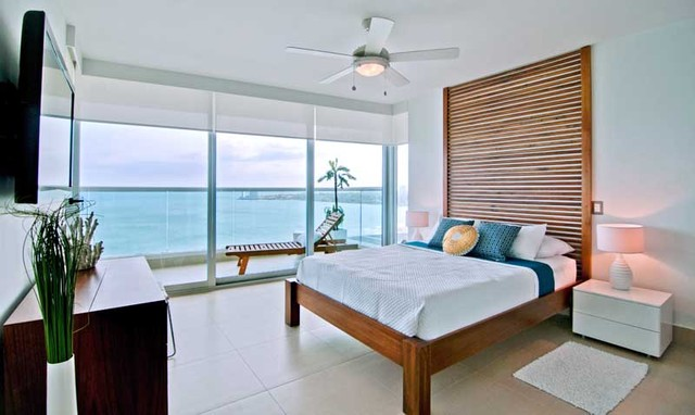white wood master bedroom beach style bedroom other metro by