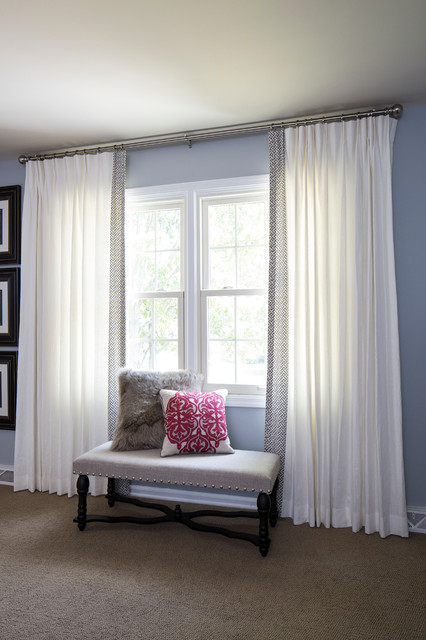 white drapes with a greek key trim contemporary bedroom