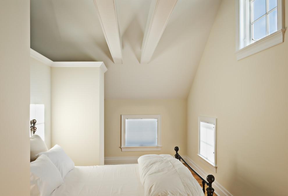 Bedroom - farmhouse medium tone wood floor bedroom idea in New York with beige walls