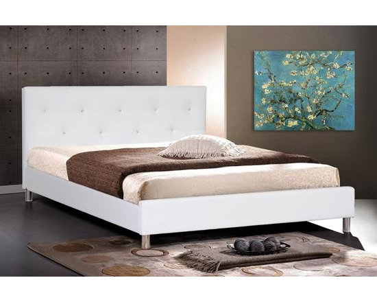 White Leather Modern Queen Size Bed Frame with Crystal Button - Made with soft white faux leather overlapping a foam-padded frame with engineered wood, this Malaysian-built creation sleeps like a dream. The queen-sized platform bed, which requires only a mattress, comes with wooden slats that serve the same function as a box spring would. Silver metal legs finish off this spectacular piece of modern bedroom furniture. The Barbara Bed is also available in black (queen size) and white (king size). To clean, wipe with a damp cloth. Assembly is required.