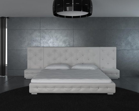 White Modern Leather Bed with Headboard 2 Nightstands - The tufted bed in white features an intricate look with the crystal-tufted accents that grace the headboard and bed frame. Clean lines and crisp white upholstery gives the unit a soft, contemporary look making it relevant in today's bedrooms. This bed is available in Queen, California King or Eastern King size. This modern platform bed is available in Black color as well.