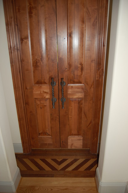 White oak & walnut inlaid floor, alder doors, twisted raw iron door pulls. - Eclectic - Bedroom ...