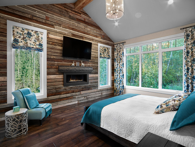 Bedroom - mid-sized rustic master carpeted bedroom idea in Vancouver with beige walls and a ribbon fireplace