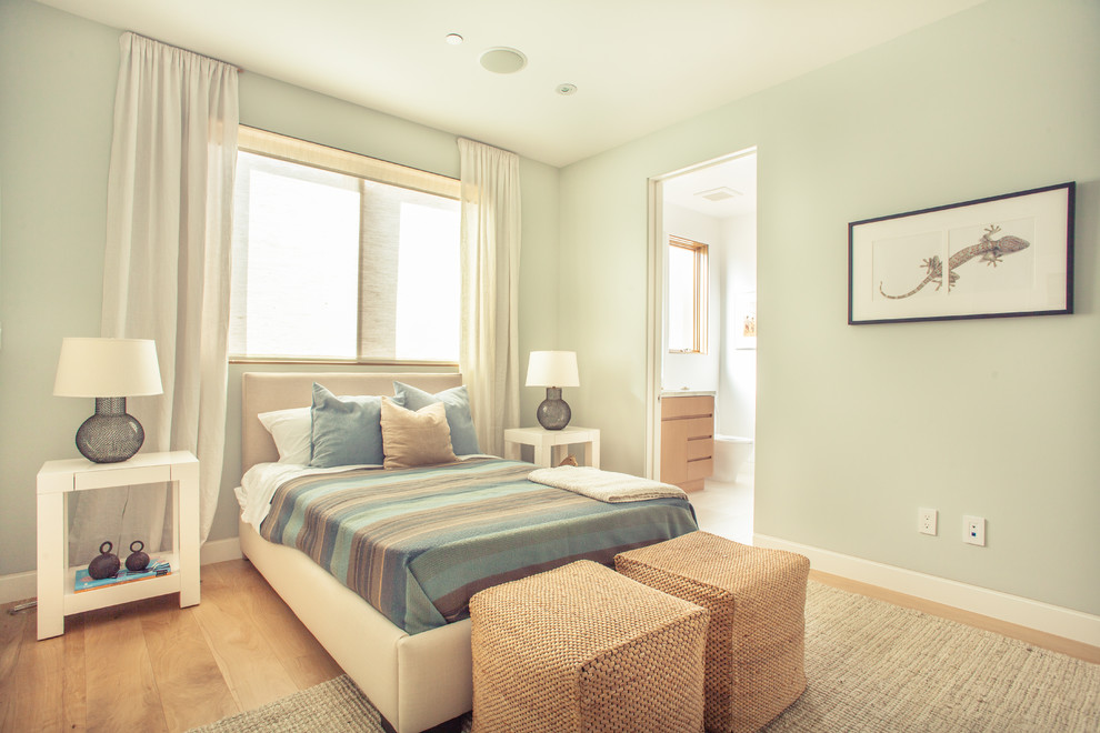 Example of a large trendy guest medium tone wood floor bedroom design in Los Angeles with blue walls