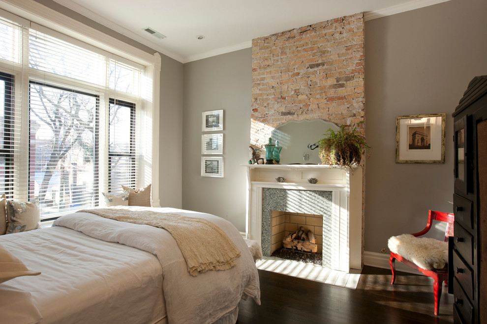 Bedroom - transitional dark wood floor bedroom idea in Chicago with gray walls, a standard fireplace and a tile fireplace