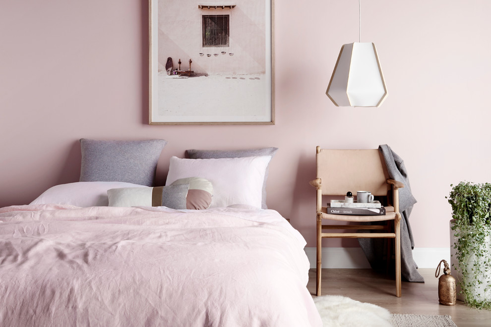 Example of a trendy bedroom design in Melbourne with pink walls