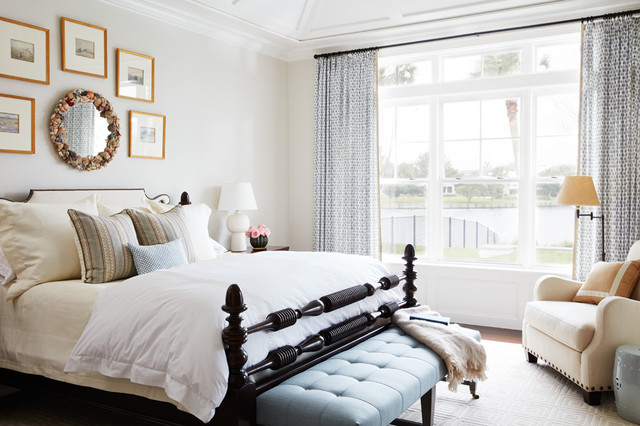 Inspiration for a large timeless master dark wood floor and brown floor bedroom remodel in Jacksonville with white walls