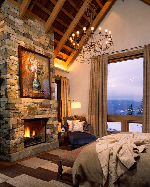 Bedroom - large rustic master bedroom idea in Denver with a standard fireplace, a stone fireplace and white walls
