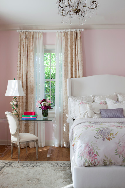 Example of a mid-sized transitional guest medium tone wood floor bedroom design in San Diego with pink walls