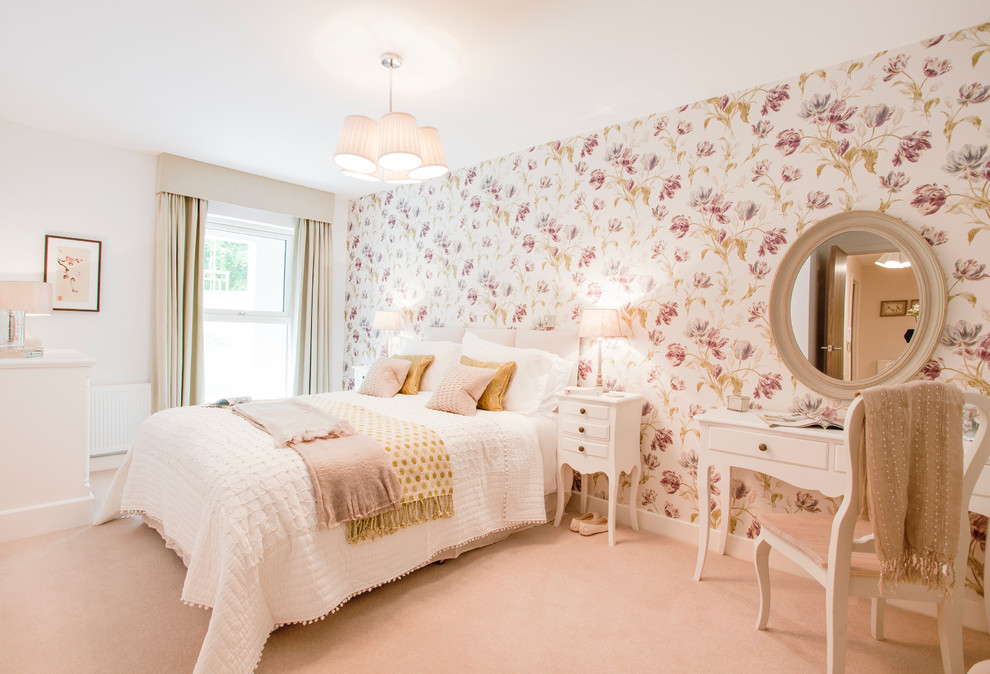 Inspiration for a mid-sized timeless carpeted and pink floor bedroom remodel in Hampshire with multicolored walls and no fireplace