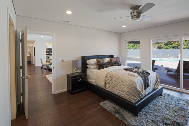 Bedroom - large contemporary guest dark wood floor and brown floor bedroom idea in Los Angeles with white walls and no fireplace