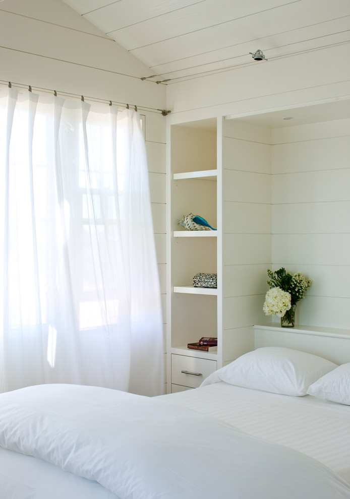 Bedroom - small coastal guest light wood floor bedroom idea in Boston with white walls