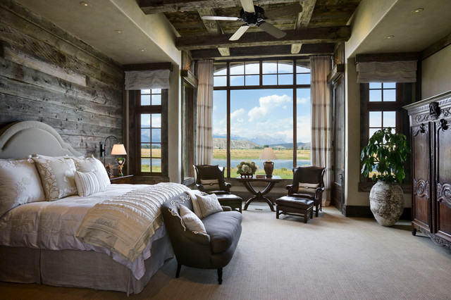 Rustic carpeted bedroom idea in Other