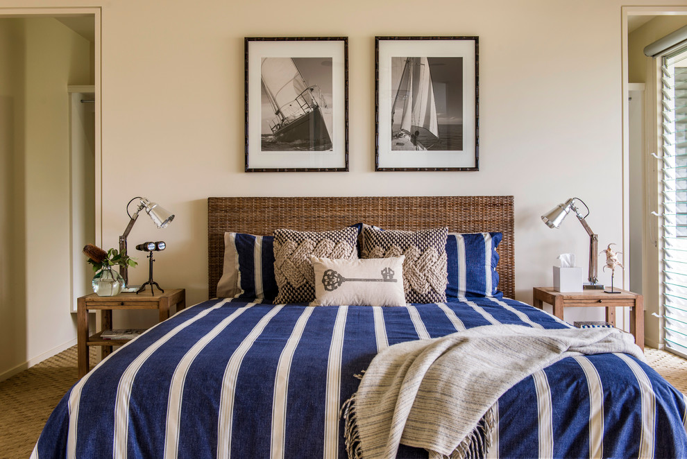 Bedroom - beach style carpeted bedroom idea in Sunshine Coast with beige walls